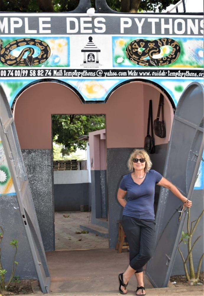 Sue standing in the doorway to the Python temple in Ouidah