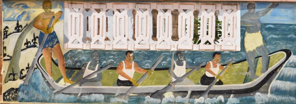 A mural depicting slaves rowing a boat at the Slave Road
