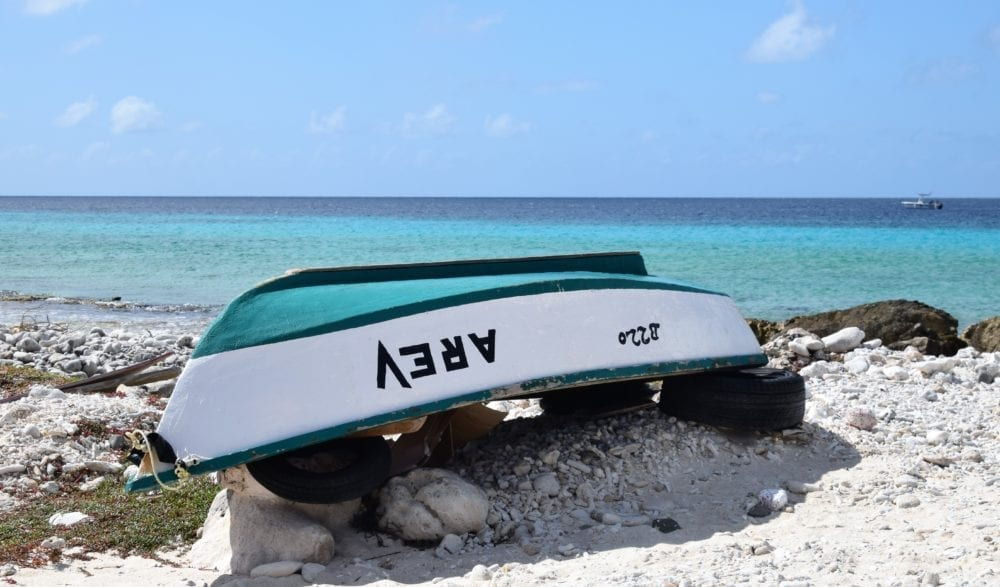 A jade keel on an upturned boat matches the sea
