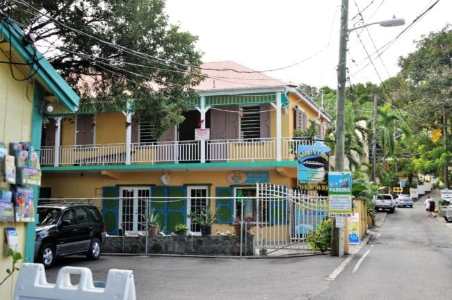 A colourful painted shop with verandah on St John