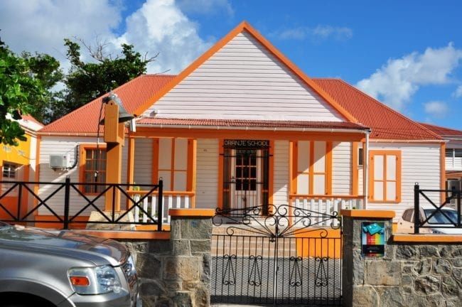 An orange and white painted school at Philipsburg Sint Maarten