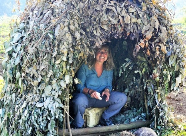 Sue in a leafy shelter, Volcanoes National Park