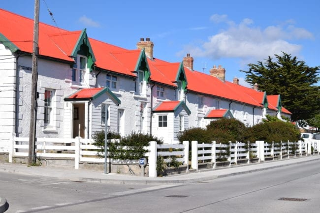A row of white houses with red roofs at Stanley Falkland Islands