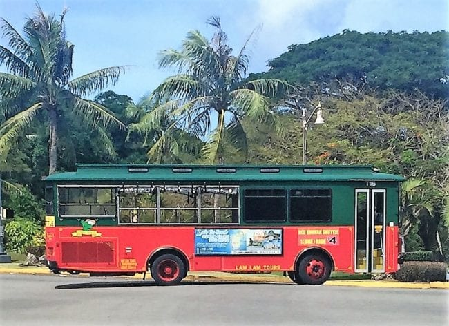 A tram style red and green bus in Guam