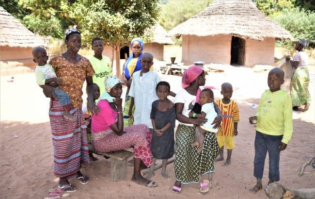 A family pose in their village iin the Fouta Djallon Guinea