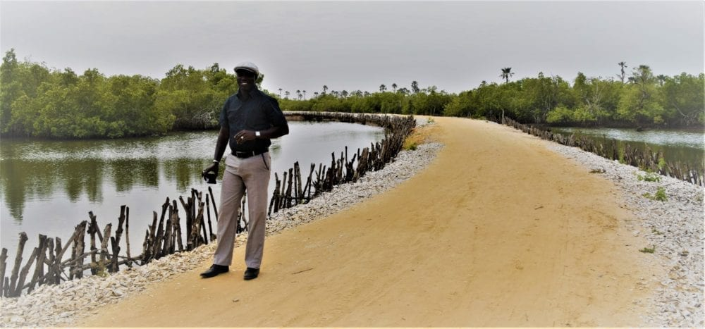 Smartly dressed Manan on the causeway at Holia