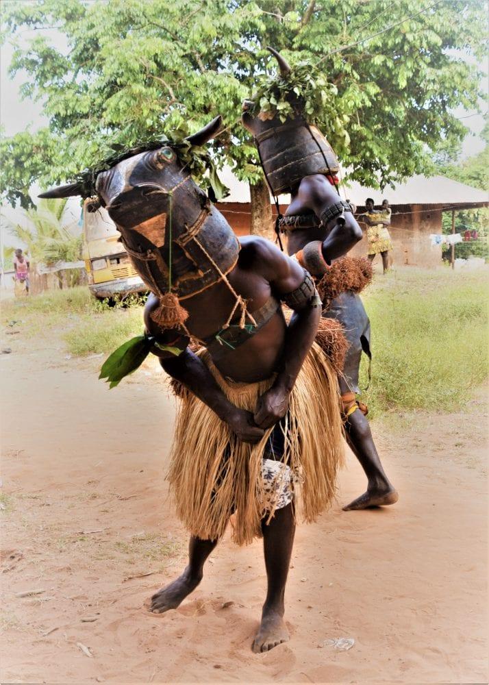 Two Baca Bruta masked dancers in Bubaque Bijagos Islands