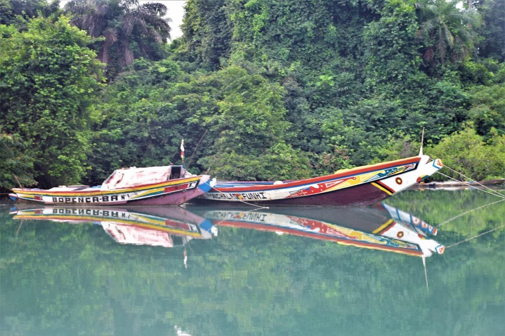 Colourful fishing boats reflected in the water Canhabaque
