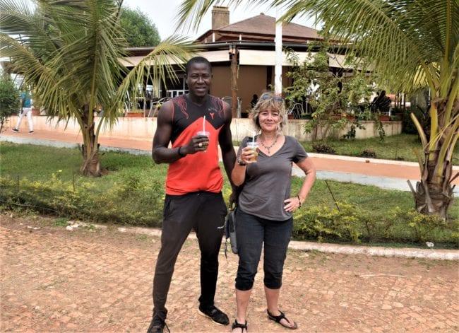 Sue and Innocencio drinking caipirinhas in Bissau