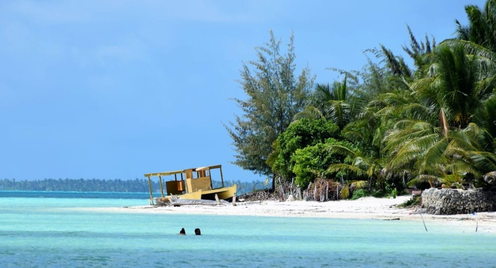 A boat on the sand at the edge of South Tarawa Lagoon Kiribati