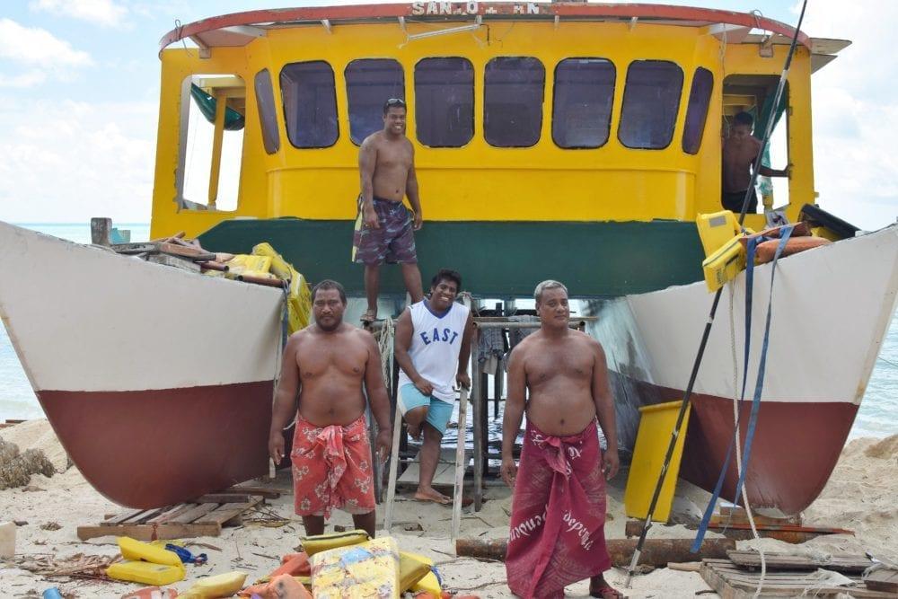 Men renovating a catamaran at South Tarawa