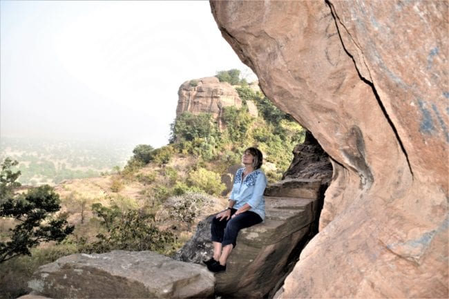 Sue sitting under Kamadjan's Arch, Mali