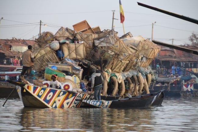 A heavily loaded boat on the river at Mopti, Mali