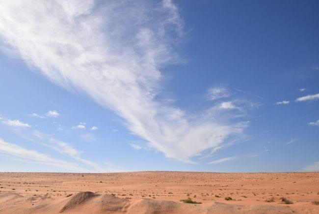 Beautiful cloud formation over flat desert in Mauritania