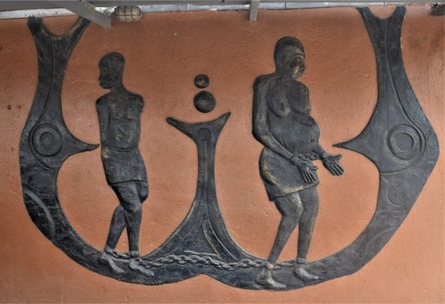 Carving showing slaves in a boat, Nigeria