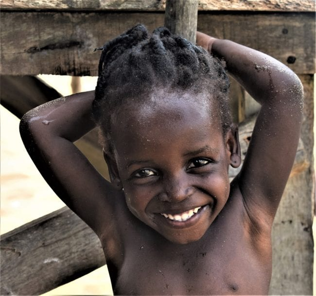 A portrait of a smiling girl on the beach in Nigeria