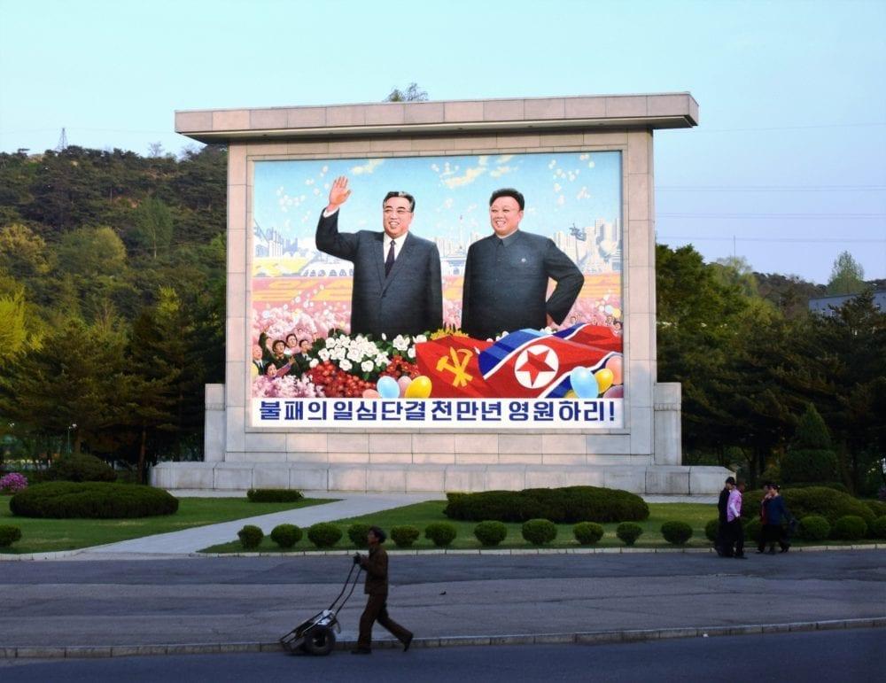 A mural showing Kim Il Sung and Kim Jong Un In North Korea