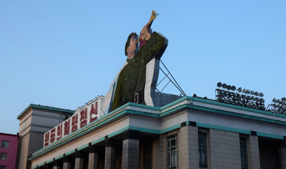 A mural of a soldier blowing a bugle above a central square in Pyongyang North Korea