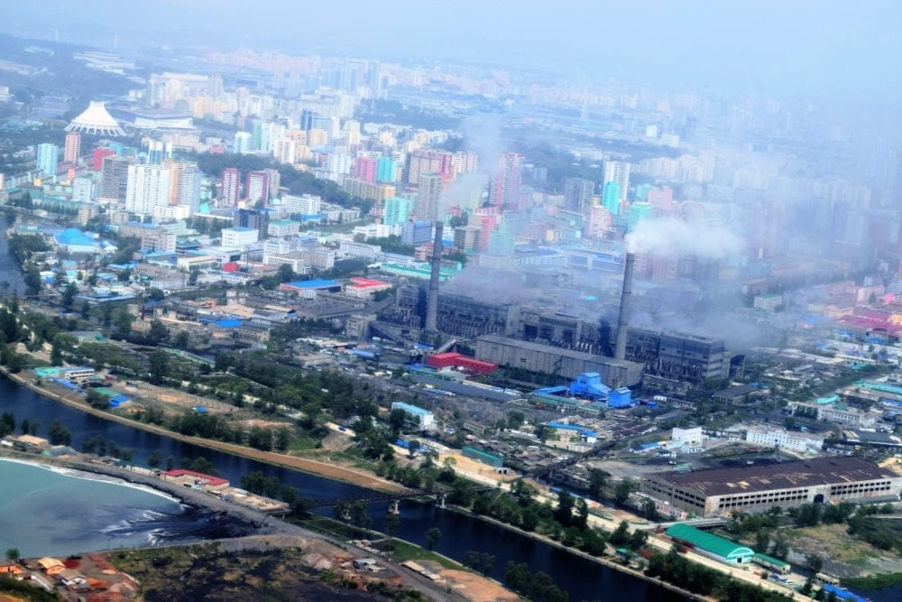 A pall of smoke rising from factories and covering Pyongyang
