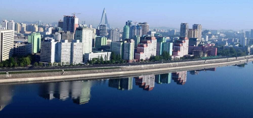 Apartment blocks of Pyongyang reflected in the river