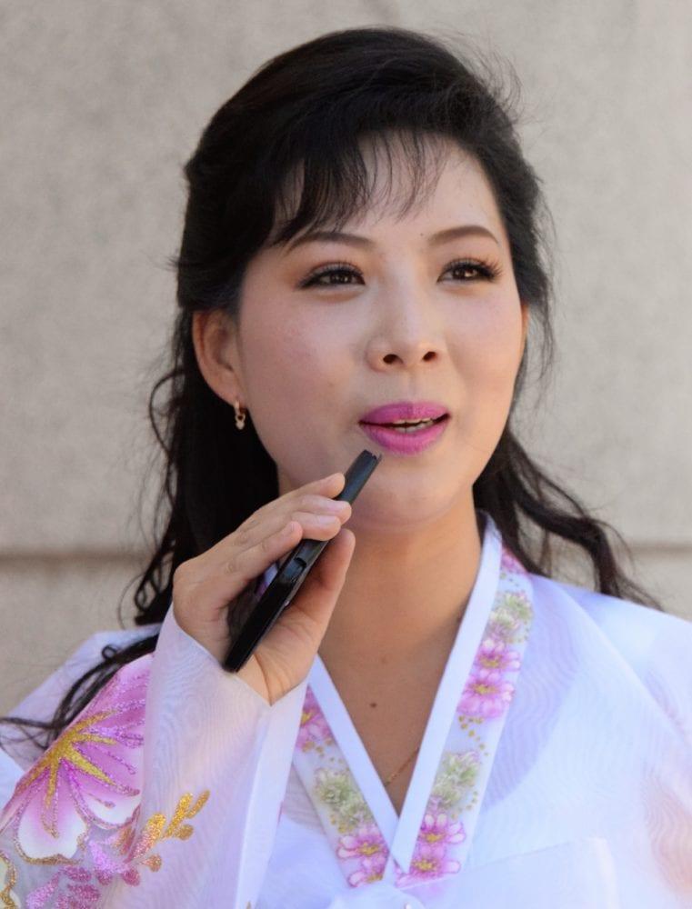 A karaoke singer on May Day in Pyongyang