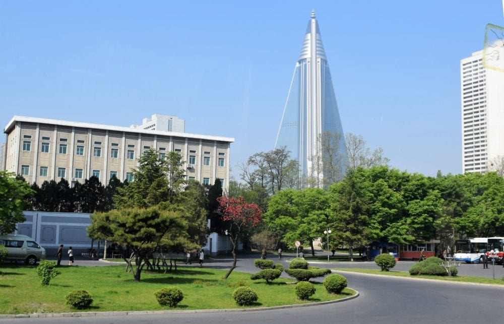View across to the new rocket shaped hotel being built in Pyongyang