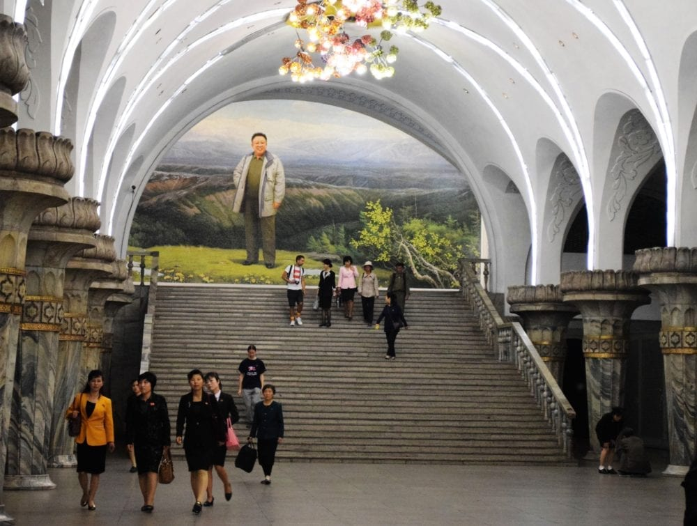 A mural in Yonggwang Station shows Kim Jong Il, standing in front of Mount Paektu, where the state media claims he was born