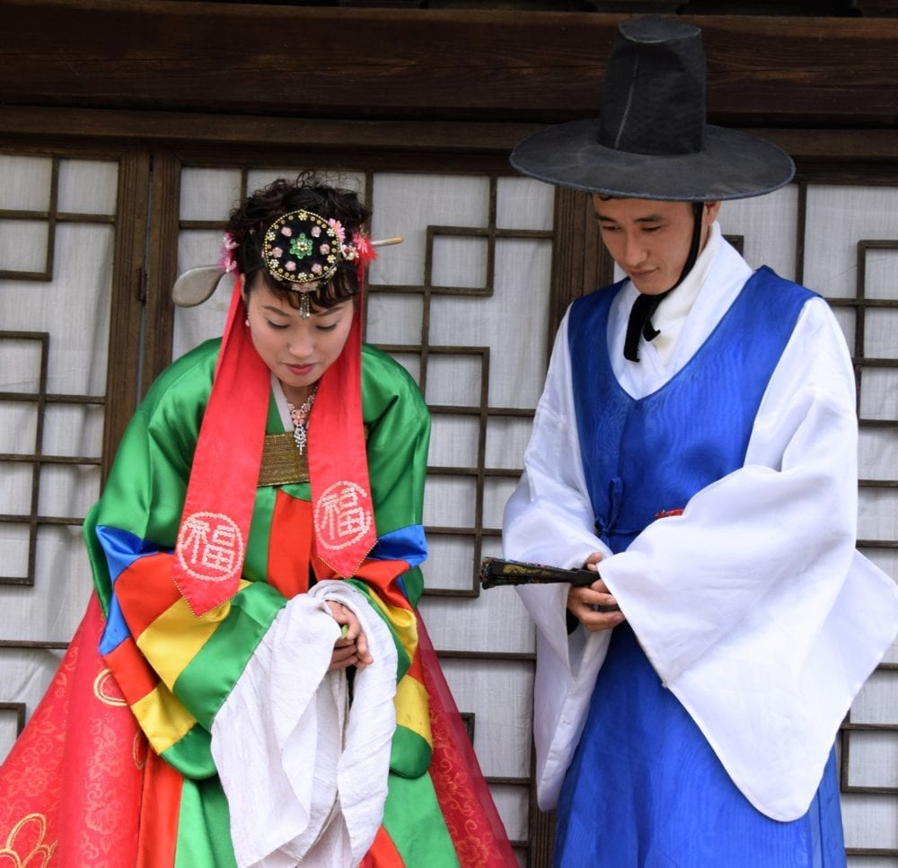 Two North Korean actors dress up in ceremonial wedding clothes