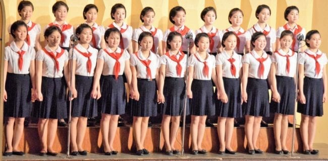 North Korean secondary school gilrs with matching hairstyles in uniform