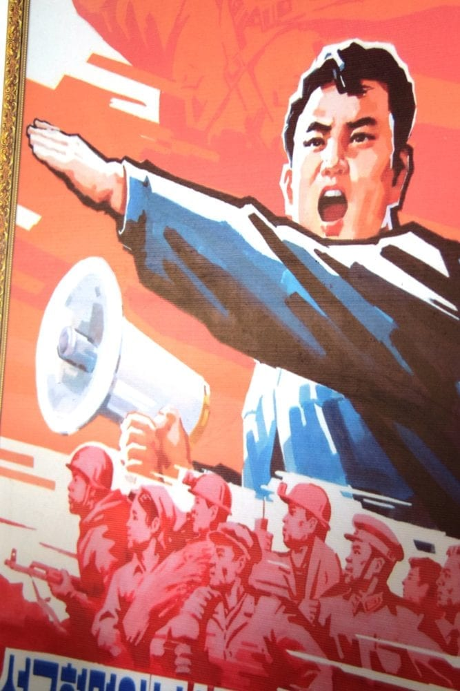 A patriotic poster in North Korea - a man with a megaphone