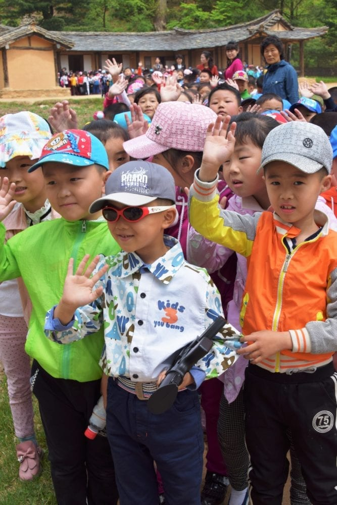 Boys carrying toy guns on a school outing in North Korea