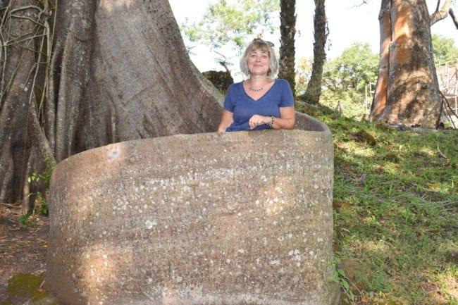 Sue in a tree root 'pulpit' on Bunce Island Sierra Leone