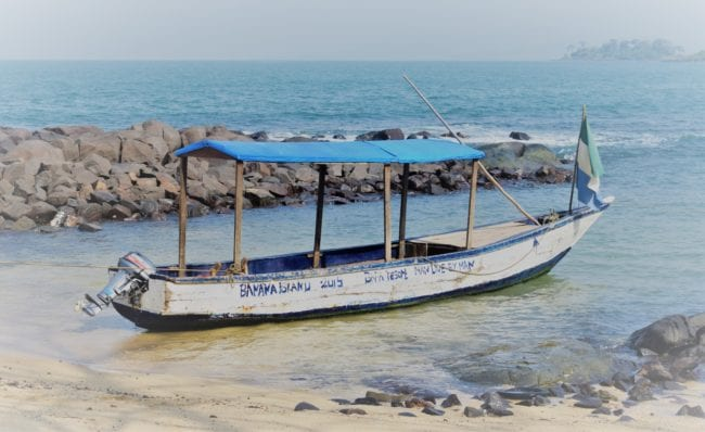 A blue canopied boat at Bunce Island