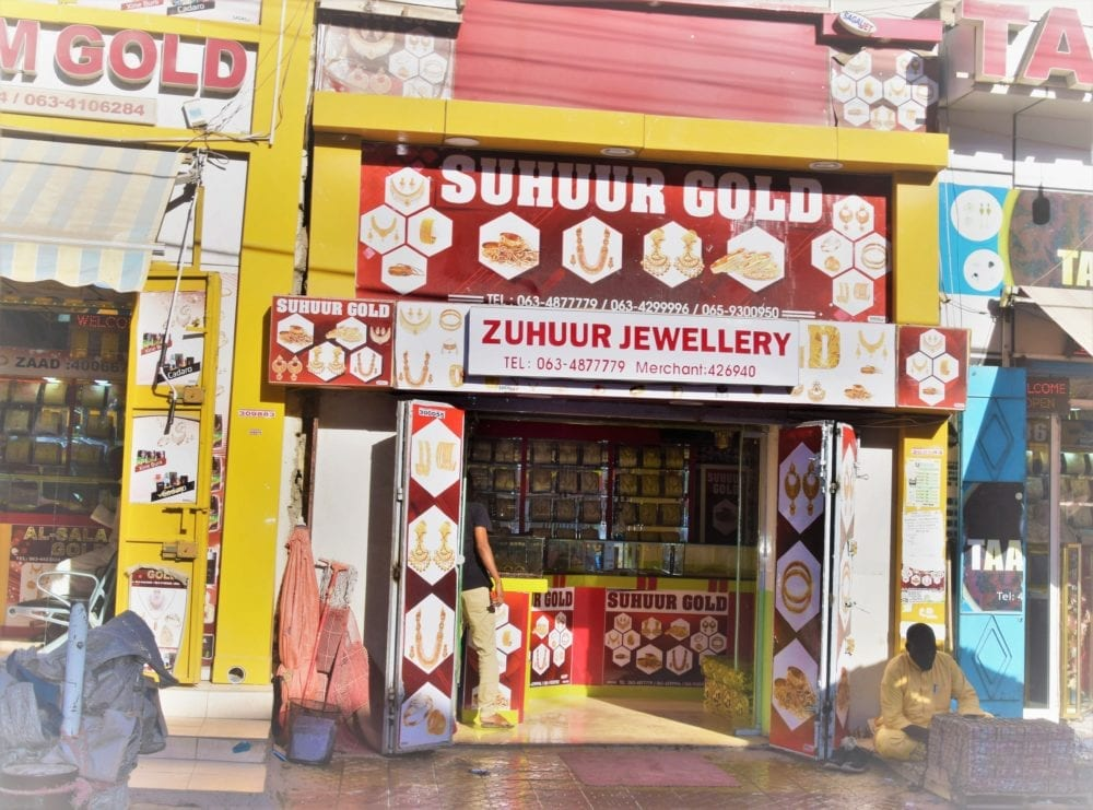 An open fronted jwellery shop painted red and yellow