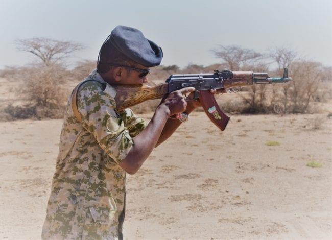 Abdi practises firing his AK 47 in Somaliland
