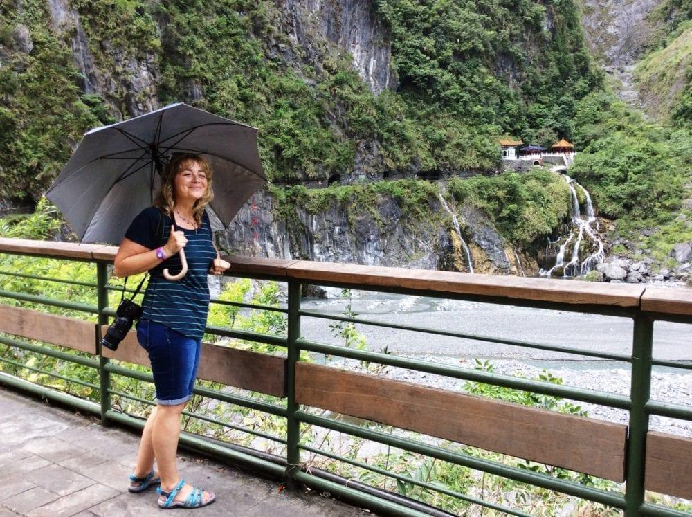 Sue with an umbrella on a bridge above Taroko Gorge
