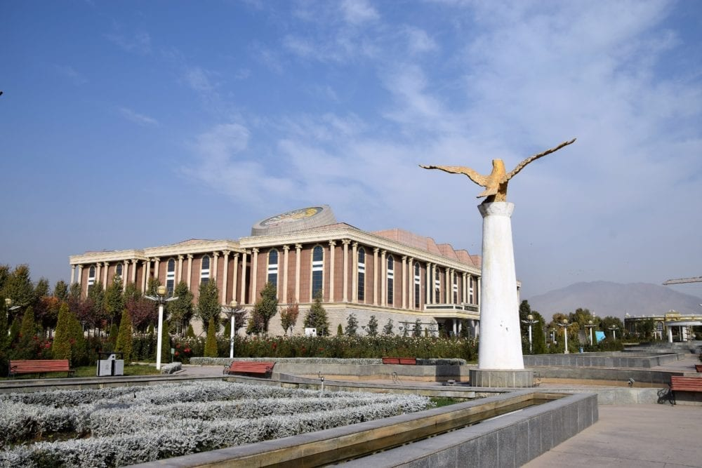 National Museum of Tajikistan behind a statue and square in Dushanbe
