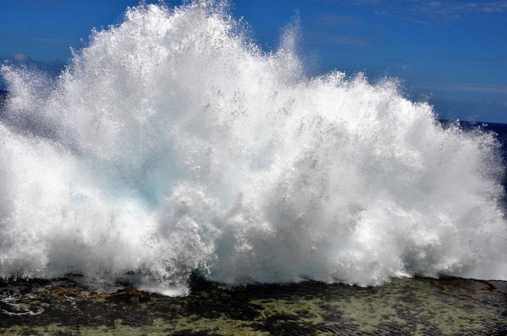 Water spurts out of blowholes in Tonga creating a massive wave
