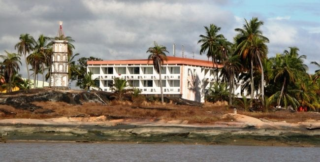 Decrepit apartment buildings facing the sea at Cayenne