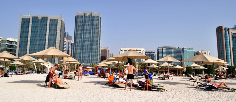 Sunbeds and umbrellas on the beach at Abu Dhabi
