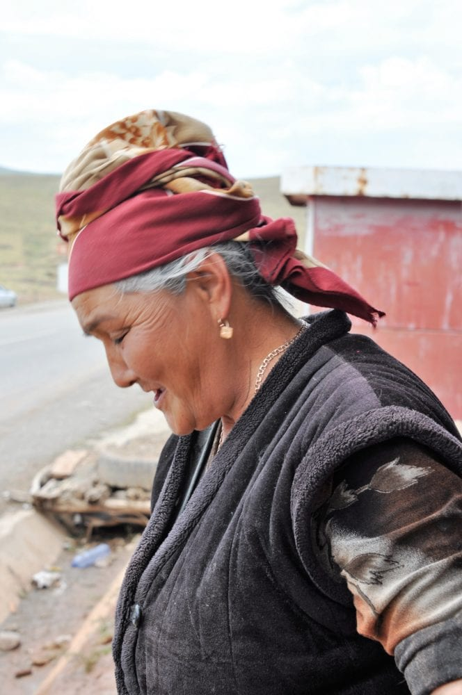 Profile of a Kyrgyz woman in a knotted headscarf