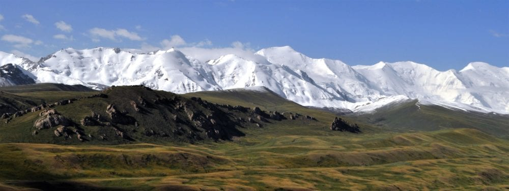 Snow covered Pamir Mountains seen from Sary Tash Kyrgyzstan