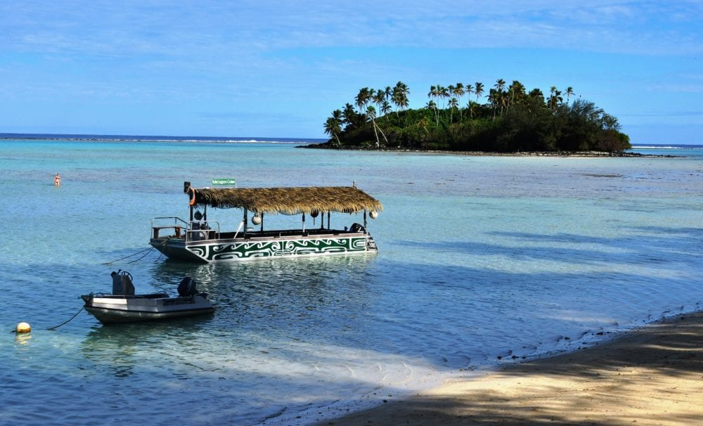 A tourist boat and a motu in the lagoon at Rarotonga