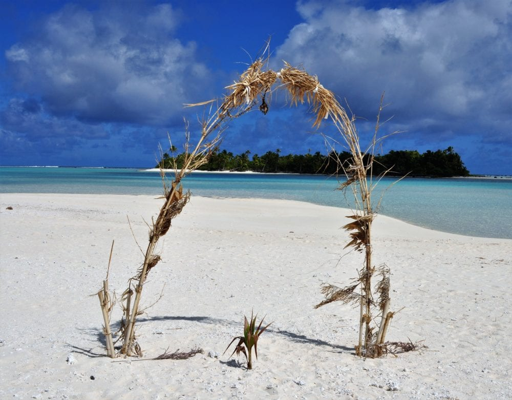 A palm branch bower on the beach, Cook Islands