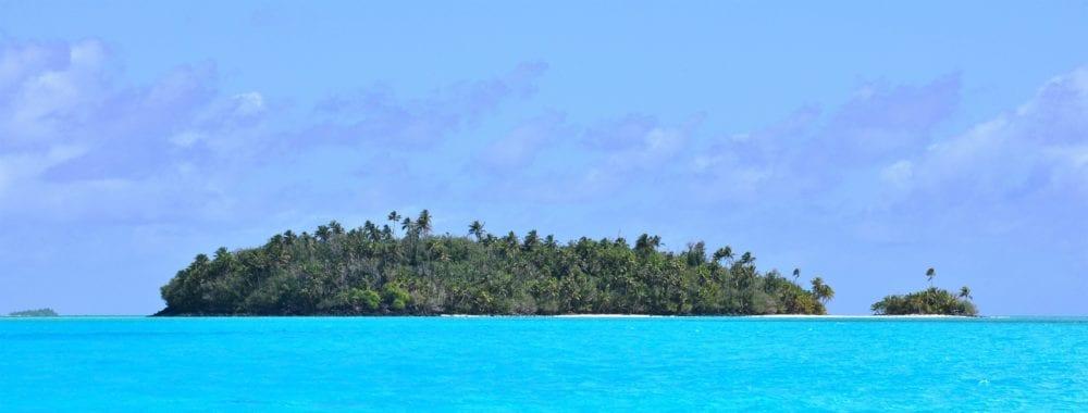 Two motus- one very small on the horizon in Aitutaki Lagoon, Cook Islands