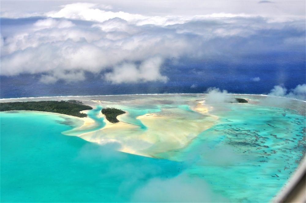Jade coloured Aitutaki Lagoon and reef rom the air