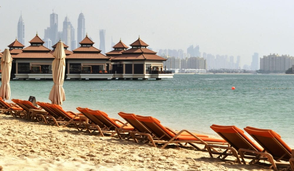 Sunbeds along the water's edge at the Dusit Thani Hotel