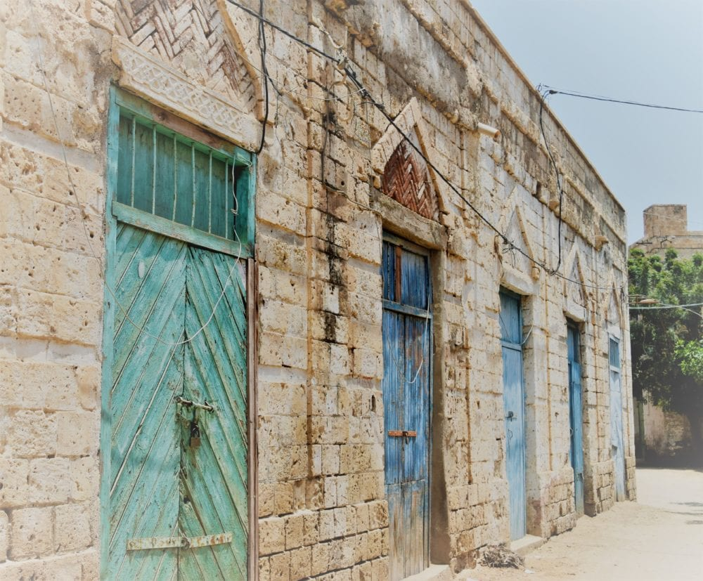 A row of decorated lock up doors in Massawa