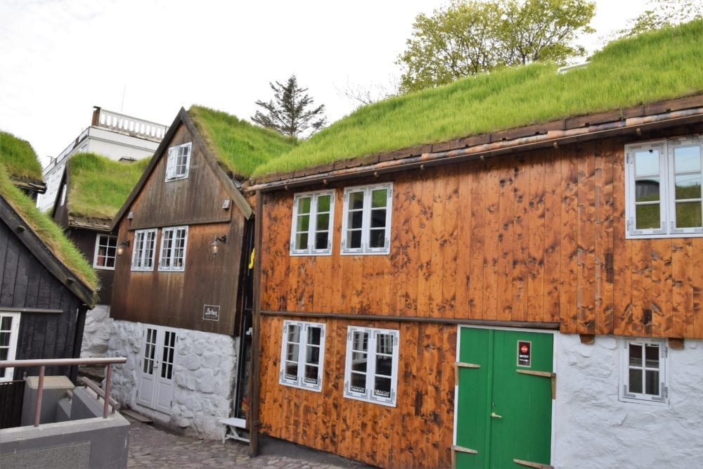 Typical timber houses with green turf roofs, Torshavn Faroe Islands
