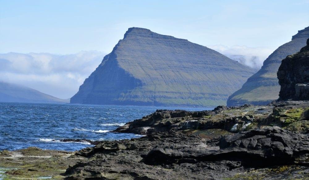 A peak jutting from the sea, Faroe Islands